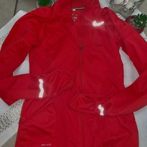 Red Nike zip up jacket (water resistant) Size.XS